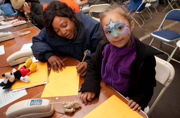 Far Rockaway, N.Y., Nov. 10, 2012 -- FEMA Community Relations specialist, Teisha Jeeter draws pictures with young disaster survivor, Luna Natalia Voss at a Disaster Recovery Center (DRC) in Far Rockaway, New York. The center was set up to assist the needs of Hurricane Sandy survivors.