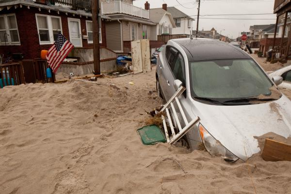 Long Beach, N.Y., Nov. 7, 2012 -- Cars were buried in sand from Hurricane Sandy. The storm surge created widespread flooding, power outages and devastation on Long Beach, New York. FEMA is working with state and local officials to assist residents who were affected by Hurricane Sandy.