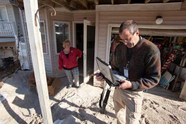 Long Beach, N.Y., Nov. 9, 2012 -- FEMA Housing Inspector, Bill Gay inspects a home in Long Beach for Hurricane Sandy related damages. The FEMA Individual Assistance program provides financial assistance for temporary housing and minor housing repairs.