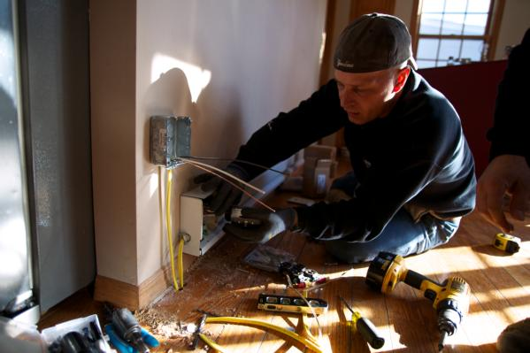 Long Beach, N.Y., Nov. 24, 2012 -- Electricians installing a heat register as part of the FEMA STEP Program. FEMA in conjunction with state, local and tribal partners, is implementing a Sheltering and Temporary Essential Power (STEP) Program to help people get back into their homes quickly and safely. STEP assists State, local and tribal governments in performing work and services essential to saving lives, protecting public health and safety, and protecting property. The program funds certain necessary and essential measures to help restore power, heat and hot water to primary residences that could regain power through necessary and essential repairs. STEP can help residents safely shelter-in-place in their homes pending more permanent repairs. FEMA is working with many partners including federal, state, local and tribal governments, voluntary faith-based and community-based organizations along with the private sector to assist residents impacted by Hurricane Sandy.