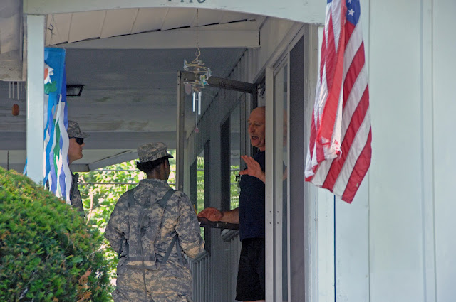 Pvt. Jason Geier (left) and Sgt. Jessica Cooper, of Headquarters and Headquarters Company, 216th Engineer Battalion, talk with Gary Rowe, of Columbus, Ohio, on July 2, 2012. (Ohio National Guard photo by Senior Airman Jordyn Sadowski)