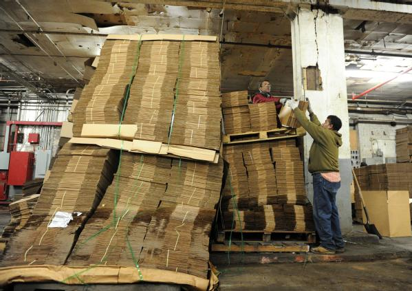 Brooklyn, N.Y., Dec. 4, 2012 -- Workers at local Red Hook business Cornell Paper and Box Company, continue cleanup of boxes inside the warehouse that was flooded during Hurricane Sandy. Business impacted by the storm may contact the Small Business Administration (SBA) for low-interest disaster loans at all New York State/FEMA disaster recovery centers and 18 SBA business recovery centers.