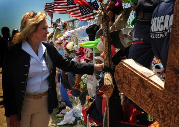 Governor Mary Fallin stops at the memorial set up at Plaza Towers Elementary School to pay her respects.
